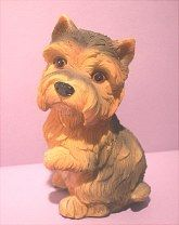 "4 1/2"" tall Yorkie.  Has two front legs..doesn't look like it in this photo."