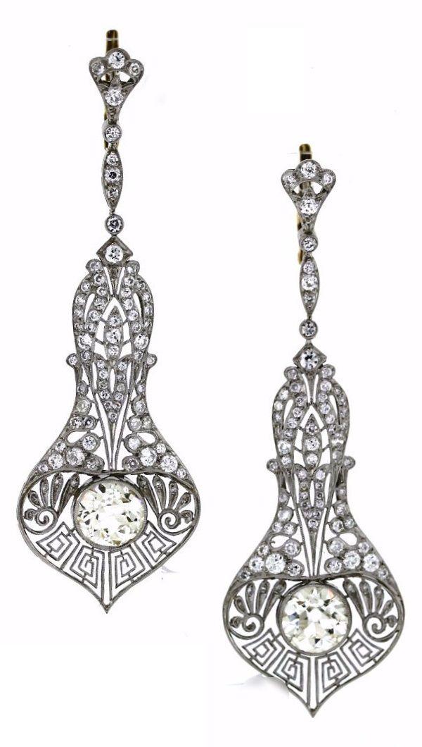 A pair of Art Deco platinum and diamond earrings, circa 1920. #ArtDeco #earrings