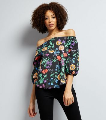 """Gear up for summer this season with this floral print bardot top. Pair with frayed jeans and sandals for a chic finish.- Bardot neckline- All over floral print- 3/4 sleeves- Soft finish- Casual fit that is true to size- Model Squad model Dionne is 5'10""""/174cm and wears UK 10/EU 38/US 6"""