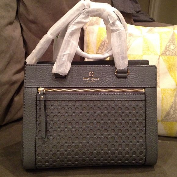 """Kate Spade Grey Bag Perforated leather with 14-karat gold plated hardware Approximate: 12"""" W x 9"""" H x 5.5"""" D Top handles with 5"""" drop; detachable adjustable Crossbody strap Front exterior zip pocket; tab snap closure Triple compartment with center zip divider pocket; wall zip, cellphone and multi-function pockets kate spade Bags"""