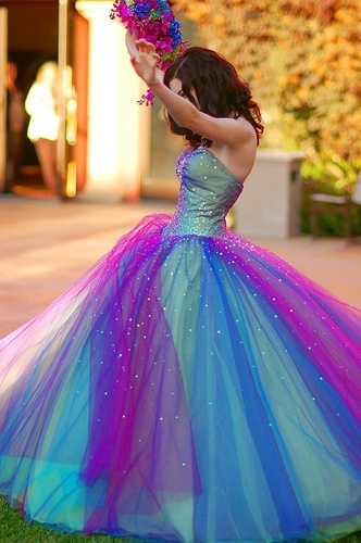 Purple and aqua dress. Would be better if was smaller like for a flower girl.