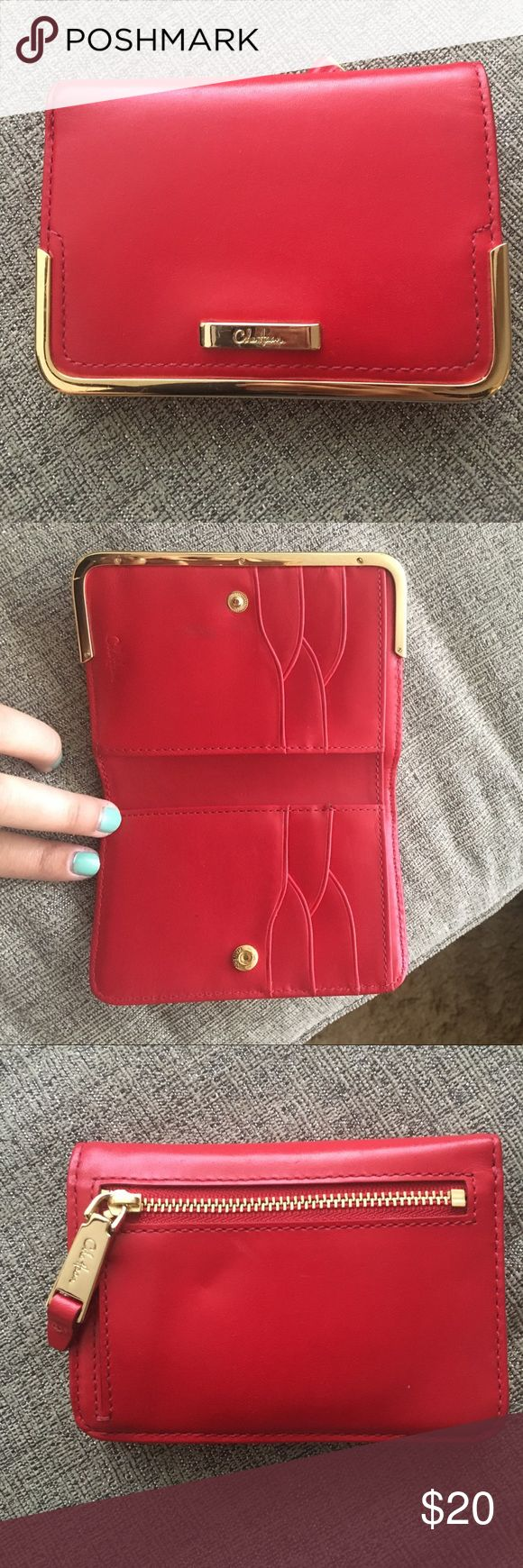 Cole Haan Red Wallet!! Cole Haan Red Wallet!! This is a super cute red wallet with gold detail. Has a small imperfection shown in last picture. Very cute card holders and change purse on the back! Cole Haan Accessories Watches