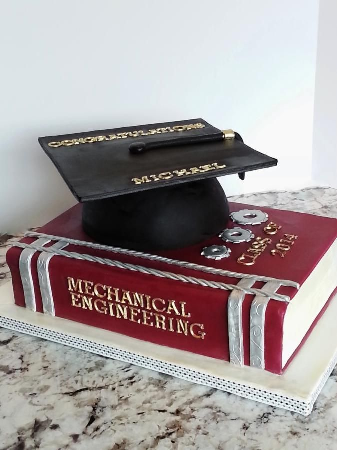 My cousins son has graduated from University as a Mechanical Engineer and she wanted a cake to represent this milestone…Cap is made of RKT, book is all fondant decorations…I also made silver mechanical gears which represented his Engineering...