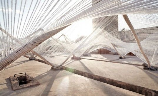 """""""Loom-Hyperbolic"""" consists of 3-D volumes woven using only natural, local materials in North Africa #appropriate #cables #wood"""