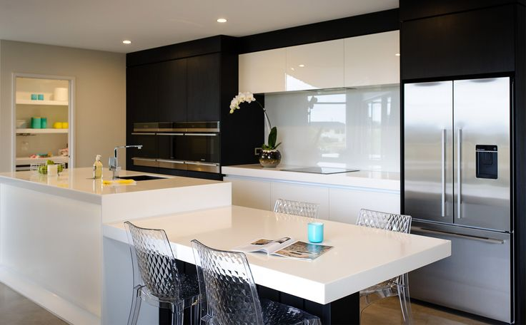 A lowered section of kitchen bench top creates the perfect space for a quick meal or the kids homework.