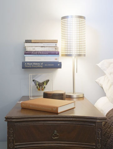 A floating book shelf. Keeps the nightstand uncluttered (unless you're me, and you've got twenty or thirty books piled up around the nightstand).