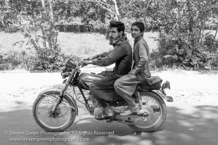 Young Men on Motorbike