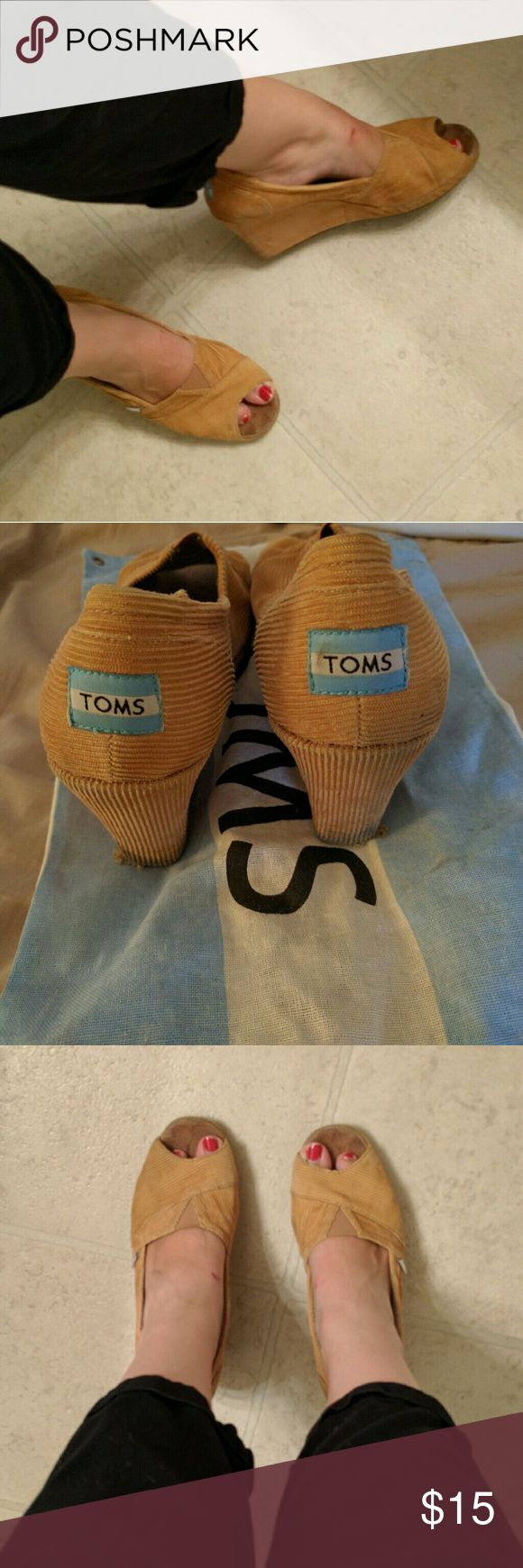 Tom wedges in bag These are worn as shown but still have lots of comfy life left in them for you. Frey is not noticible when standing. They want a second life! Toms Shoes Wedges