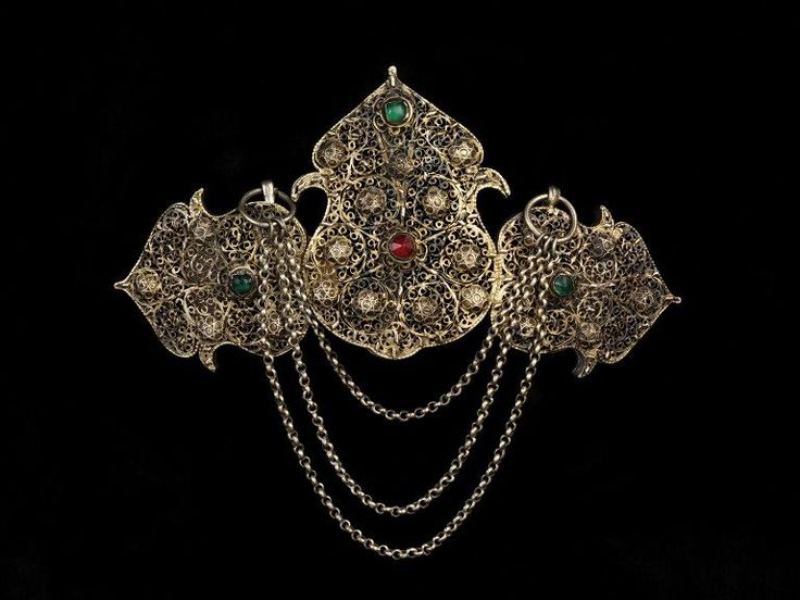 Clasp, 1750-1850.The goldsmiths of Cyprus were famous for their filigree, although they rarely marked their work. This clasp is a rare exception, and may have been made outside the island, as it is marked three times with the tughra, which was the official silver mark of the Ottoman Empire