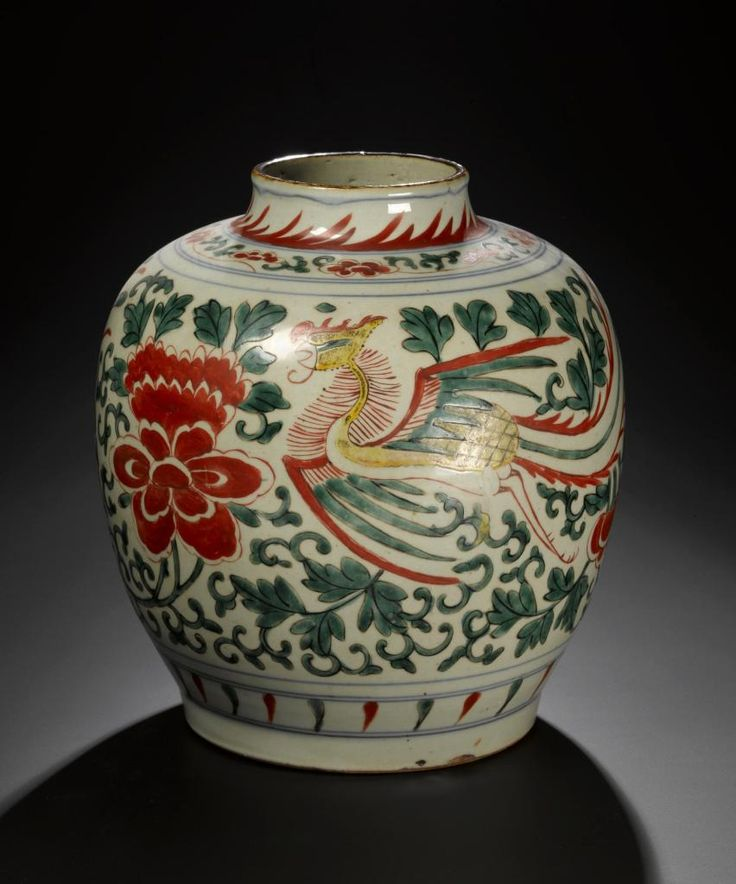 Porcelain jar, decorated in red, green and yellow enamels with a pair of feng-huang (phoenixes) amid peony flowers and foliage: China, provincial export ware, Ming or Qing dynasty, 17th century