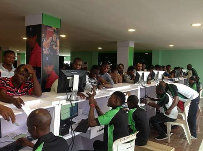 6 Reasons Nigerian Youths Engage In Sports Betting   Well be as it may Nigerians have taken solace in sport betting. Its now a new normal in Nigeria to see young people especially on the streets and queues struggling their way to place their bets on the five major leagues in world football.  The English premier league Spanish Primera la Liga Italian Serie A German Bundesliga and the French league. Other minor leagues are also not excluded. In short Nigerian youths have seen sport betting as…