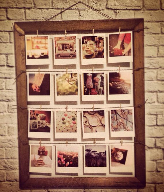 Frame + twine + mini clothespins + instagram prints.  I've got everything except the frame.  Will be doing this soon.