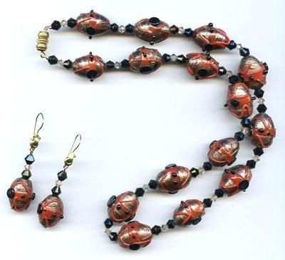 Vintage Venetian Murano Lampwork Aventurine burgundy Red burnt orange color and Black Wedding Cake Oval Glass Bead choker Necklace and matching dangle pierced Earrings Set. $44.95