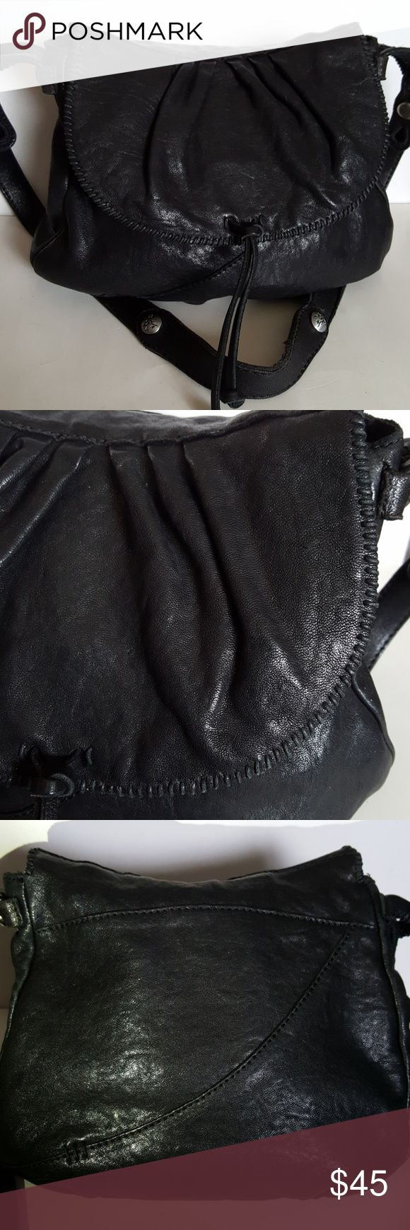 LUCKY BRAND PURSE Beautiful Lucky Brand Slouchy Hobo Shoulder Bag in Lamb Leather. 1 zipper pocket, 2 slip pockets inside and magnetic closure. Black fabric interior.  Whiplash detail gives it great style. Bag is in very good condition with very minor wear on parts of handle (see picture). Overall very good condition.  Please ask questions or for more pictures if needed.  NO TRADES. Lucky Brand Bags Hobos