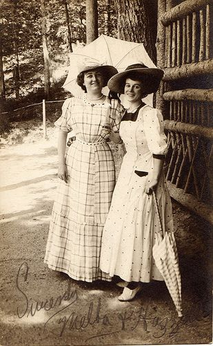 "Two women with parasols, ""Sincerely, Melba & Hazel,"" circa 1910"