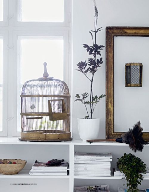 Vignette with Birdcage & Feather Duster in the home of Tine Kjeldsen via Elle Decoration