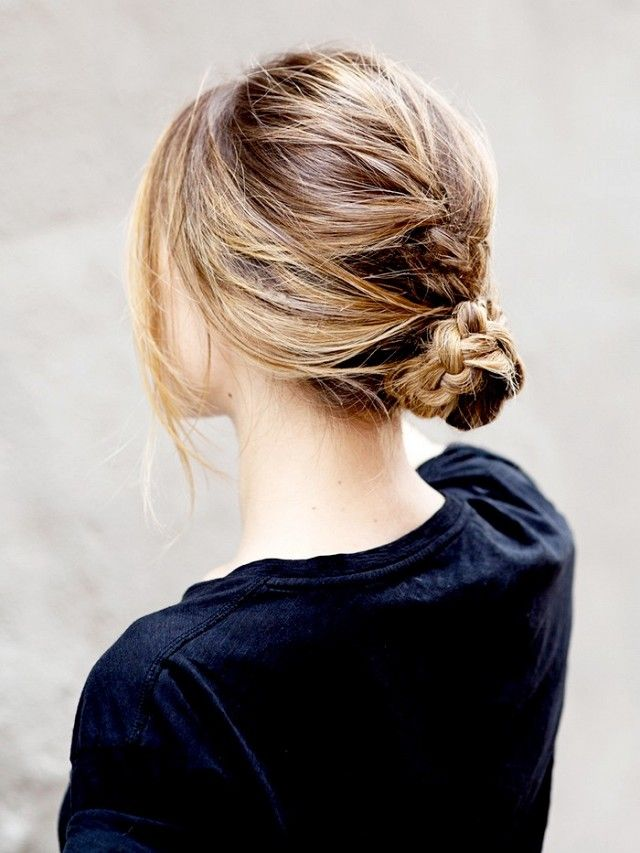 Braided messy bun: Simply french-braid your hair down the back, twist the braid into a bun at the nape of your neck, and secure with bobby pins.