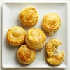 Melty Cheese Puffs  Flaky puff pastry wraps gooey cheese in a made-to-mingle party snack. Assemble the puffs well ahead of the party. Pop them in the oven in time to serve the cheesy puffs at their toasty best.