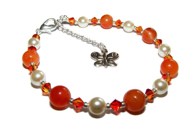 Carnelian Gemstone, Swarovski Pearl and Crystal Bracelet.   Beautiful for the Summer for both weddings and every day wear this vibrant bracelet is created using energising 8mm Carnelian Gemstone rounds and 6mm Swarovski Cream Pearls. It is accented with stunning optically pure Fire Opal Swarovski Bicone Elements.   £16 inc p&p (UK) http://mysticearth.co.uk/carnelian-pearl-and-crystal-bracelet.html