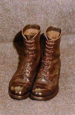 The feared marching boots. Spit and polished for inspection.