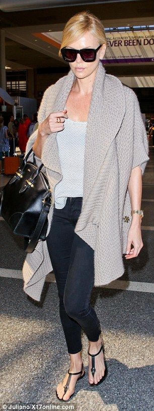Charlize Theron looks downcast as she jets out of Los Angeles #dailymail