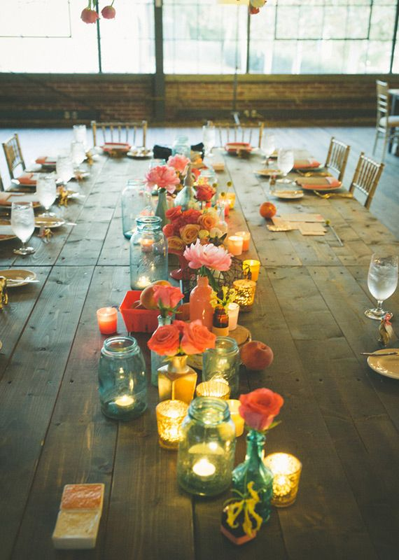 rustic modern tablescape with blue mason jars, bottles and other eclectic vases for wedding centerpiece | photo: Jason Hales