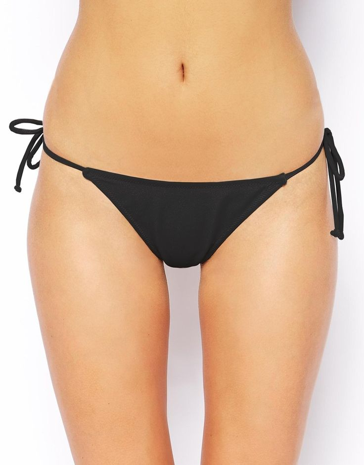 Bikini briefs by ASOS Collection Made from a stretch swim fabric Hipster rise Tie sides Thong cut to reverse