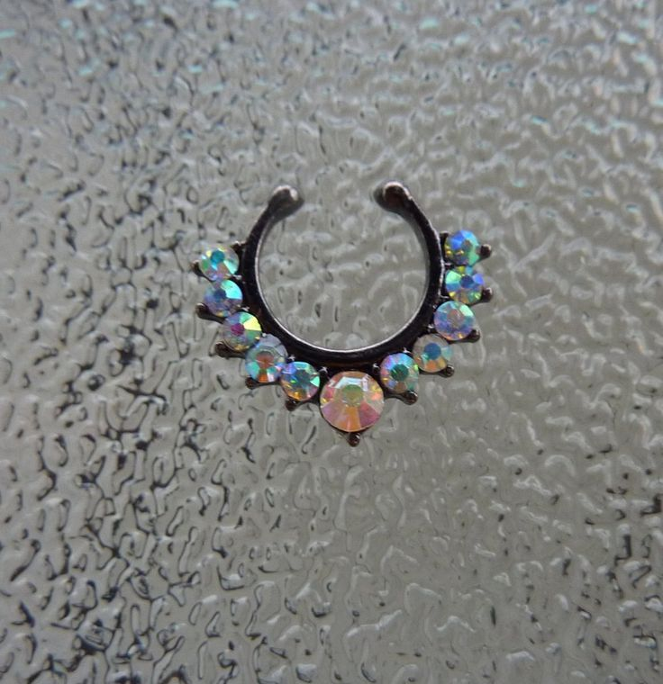 This is a black (gun metal) colored fake septum ring with aurora borealis crystals. It will ship the next business day after it is ordered. Please message me with any questions. Like my Facebook page!