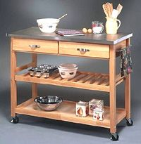 Portable kitchen island with countertop for work, drawers for utensils, shelves and towel racks