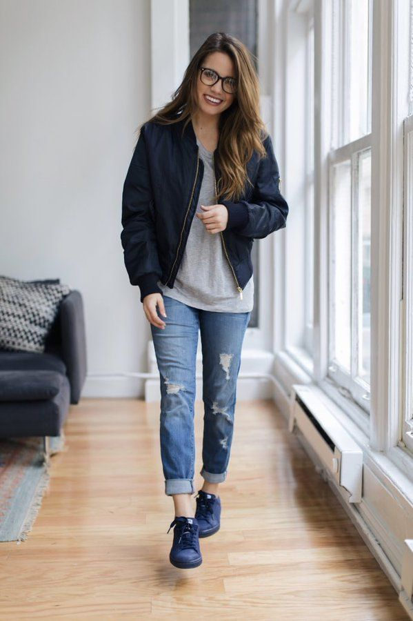 distressed jeans, grey top, navy blue bomber jacket, sneakers