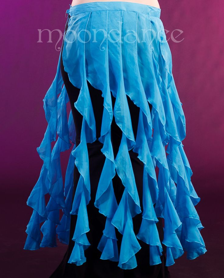 "Wrap around ties skirt with long frills.   Skirt is 38"" around plus ties.  Looks great over pants or skirts."