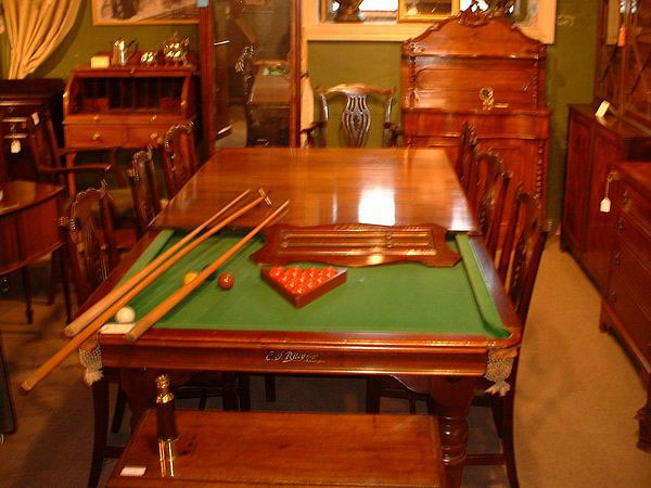 Mahogany dining room table that converts to billiards table ;} How kewl is that! Spotted in Long Melford, Suffolk, England on a cooksinfo.com kitchen fittings hunt....