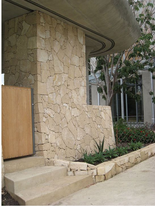 Exterior: 'spalled' Limestone Wall