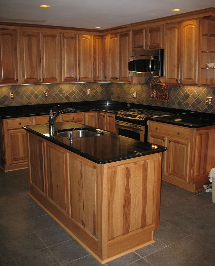find this pin and more on ideas for the house love the hickory cabinets slate backsplash and black granite
