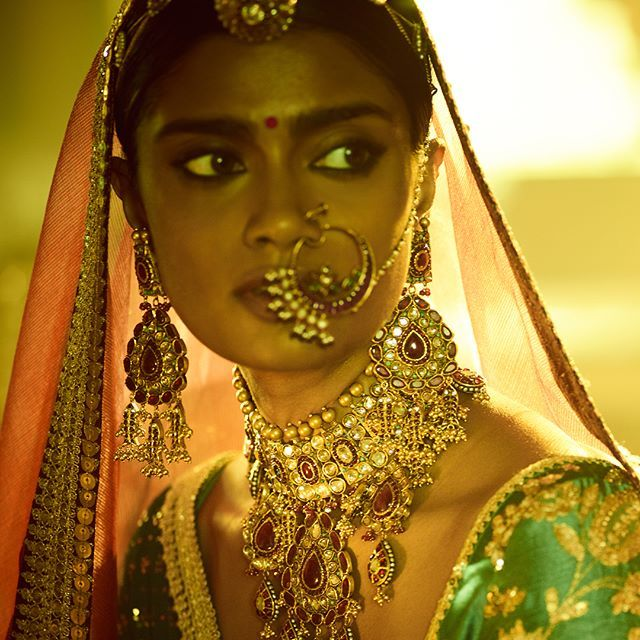 The Baroda Collection  Rustic fabrics, tissue odhanas, a proud borla on the forehead and family heirloom adorning the body. Featured here: Heritage gold jewellery with 'Navratan' detail from the Sabyasachi Heritage Jewelry line. Embellished with gold beads, cabochon Rubies and vintage finds from 'Lal Katla' in Jaipur.  #Sabyasachi #TheBarodaCollection #Bridalwear #DiamondJewellery #JadauJewellery #GoldJewellery #BridalJewellery #SabyasachiJewelry #IndianDesigner #IndianCouture2017…