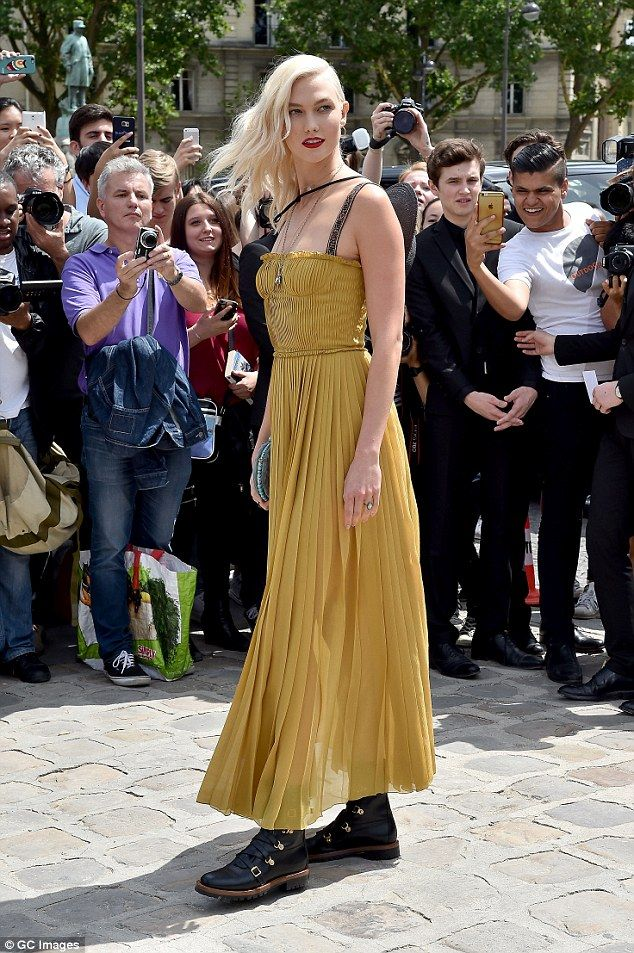 Turning heads:All eyes were on Karlie, 24, as she made her big arrival at the star-studded Dior show, which was held at Paris' Cloître Port Royal gardens