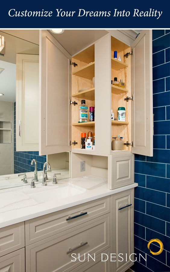 Double entry cabinets make it easy to grab those things stashed in the back - and an opening at the bottom grants easy storage for electric toothbrushes, razors, and blowdryers. You can even sneak the cord into the drawer below for storage! Get more remodeling ideas at www.sundesigninc.com for Northern Virginia design + build needs.