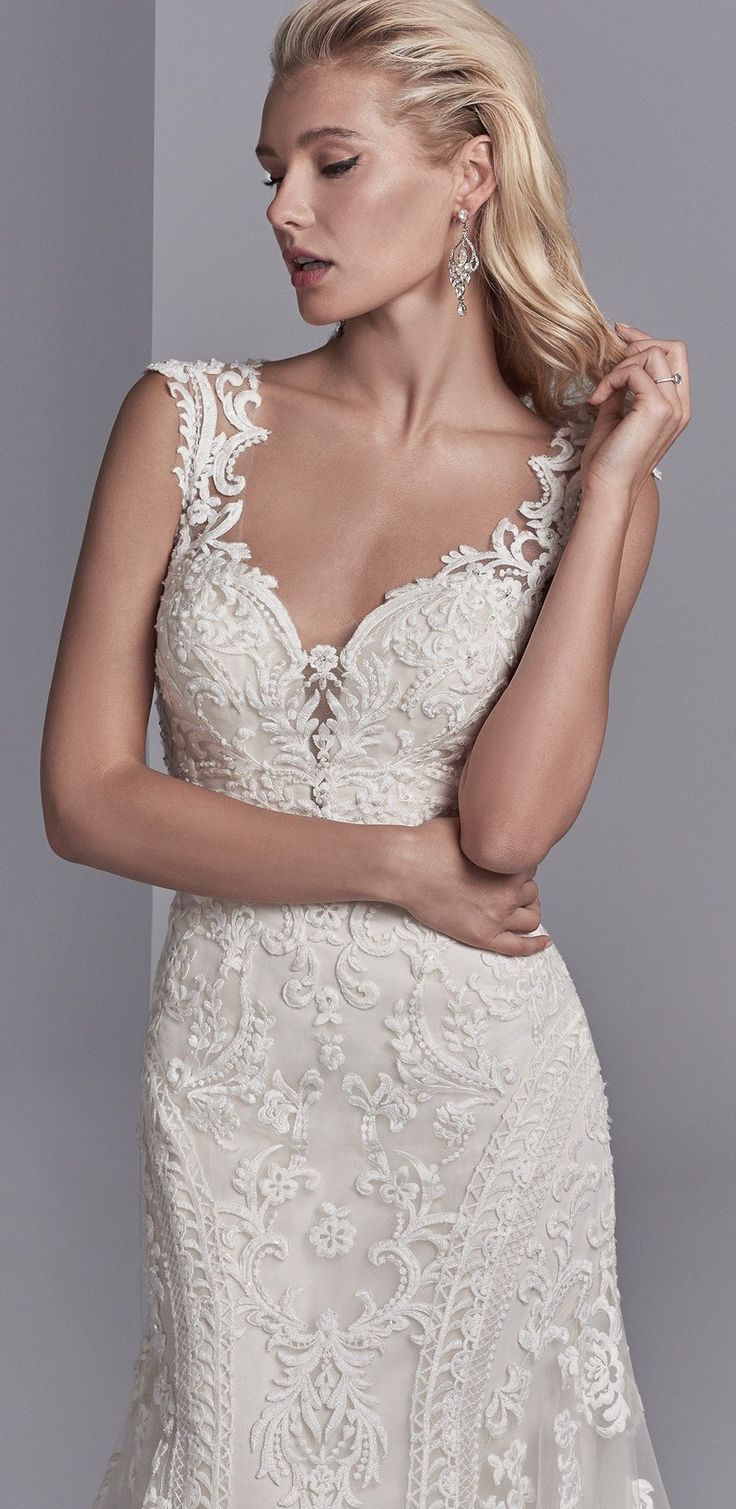 NOVIAS Love this neckline... flattering and romantic, but uniquely modern. Channing Rose by Sottero and Midgley, featuring built-in shapewear.