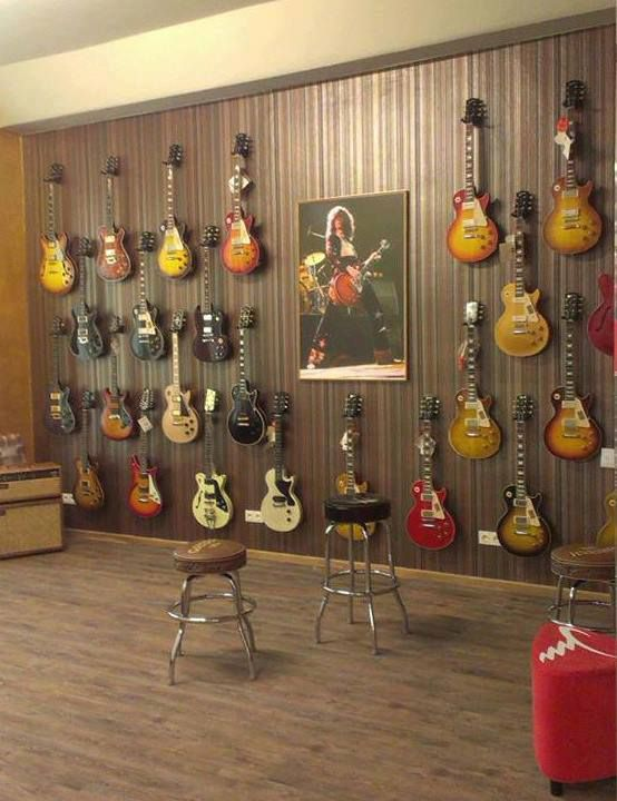Wall of Jimmy Page's Les Paul Signature guitars on temp loan for shot…