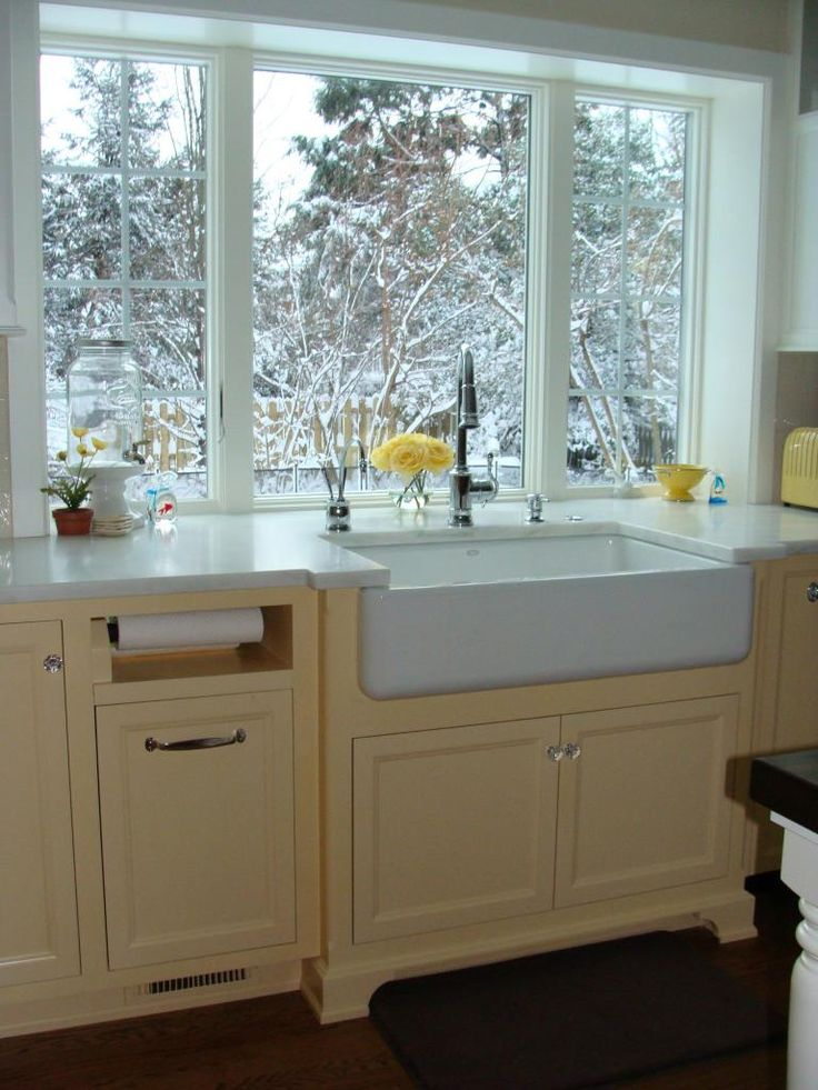 Counter-height windows. like the sink and paper towel spot and I bet under that is a garbage can that pulls out. ;-)