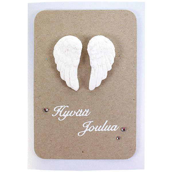 Massasta muotin avulla tehdyt siivet sopivat vaikka korttien koristeeksi.