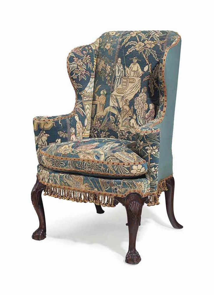 AN ENGLISH WALNUT WING ARMCHAIR  THE LEGS AND NEEDLEWORK 18TH CENTURY