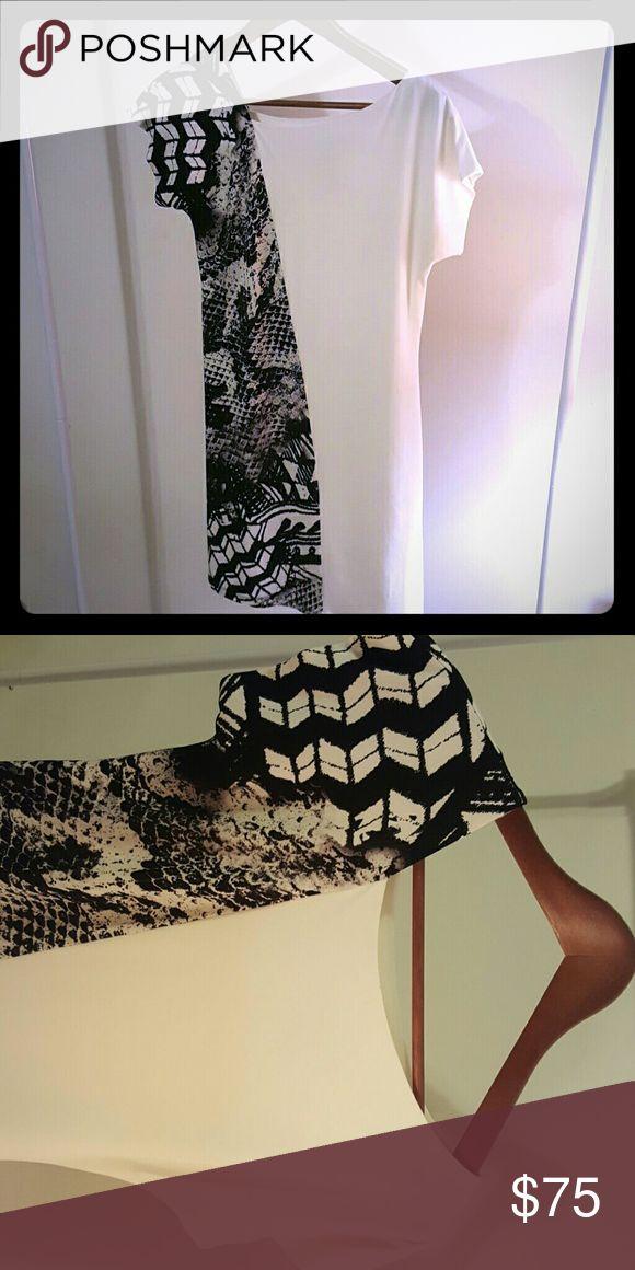 Donna Morgan asymmetrical dress A Donna Morgan asymmetrical printed dress in black and white. Neckline is also asymmetrical. In great condition, really comfortable! Donna Morgan Dresses