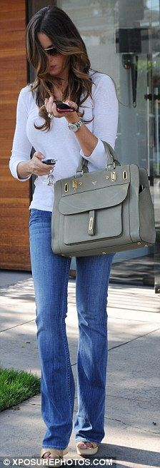 Sofia Vergara. Love her. Does anyone know where purse is from?
