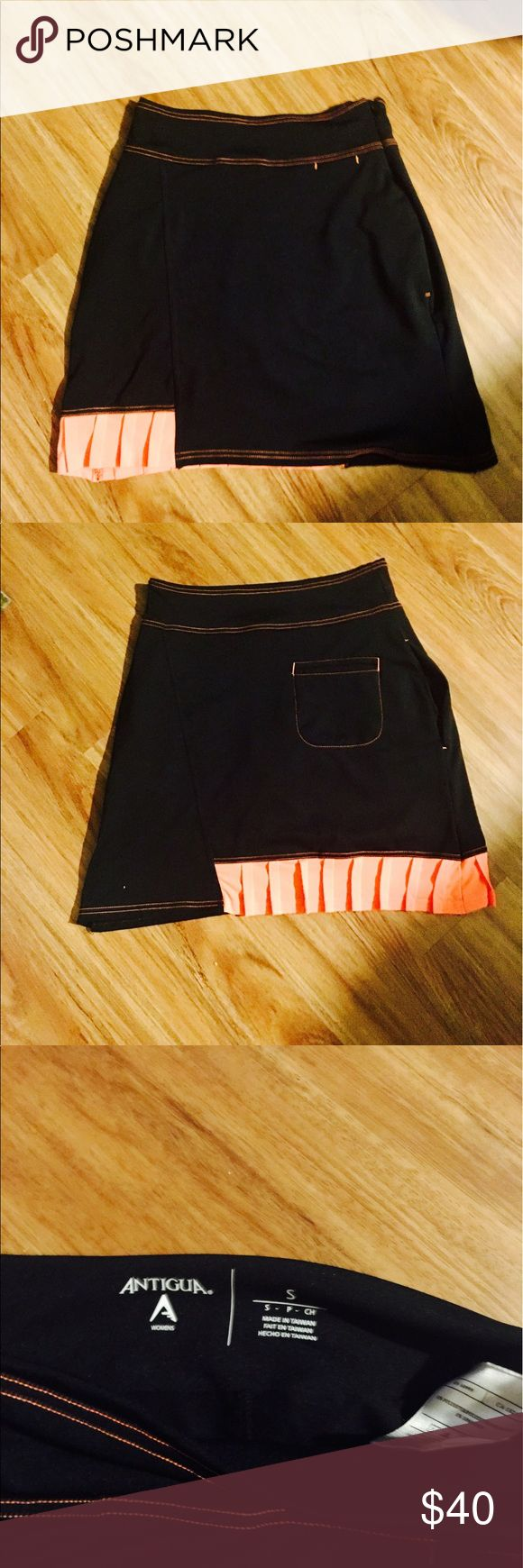 """NWOT ANTIGUA Tennis Skirt I have two of these fashionable tennis skirts - size Small. They are both brand new without tag. -------   Black w bright coral color! So pretty!! They also have pockets-                                                               I think they are also cute to for golfing or as a bikini """"cover-up""""I am selling them separately but pls let me know if you would like them both. Feel free to ask any questions :) 🎾 👙🏌️♀️ Antigua Skirts"""