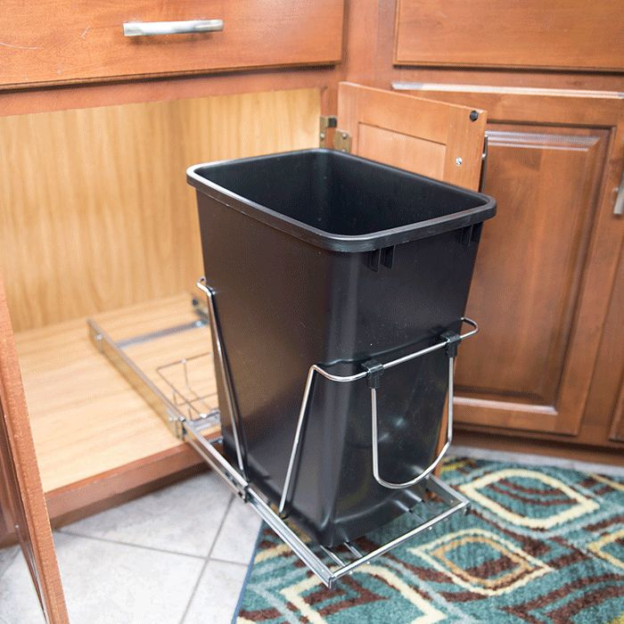 Make your kitchen more efficient by installing cabinet organizers near work areas. Our guide shows how to install slide-out organizers, a slide-out trash can and a door-mount trash can.