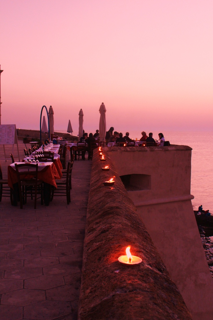 Al fresco dining in Gallipoli, Italy. ( A. Carman) Puglia by night and dancing