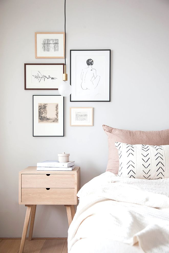 neutral gallery wall with neutral textiles