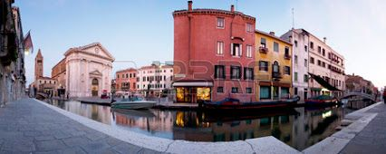 Panoramic view of the Ponte San Barnaba bridge over the Rio de San Barnaba river, the Campo San Barnaba square and the Chiesa San Barnaba church.