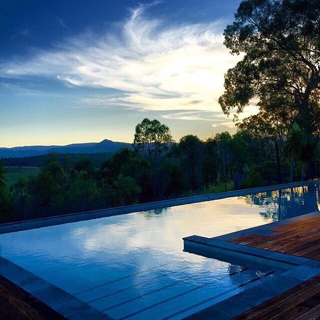 An amazing sunset over the lap pool at Spicers Hidden Vale #spicersretreats #spicershiddenvale